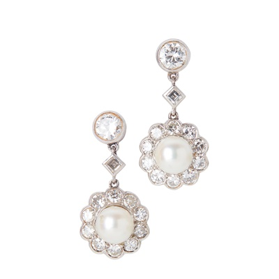 Lot 43-A pair of pearl and diamond set pendant earrings