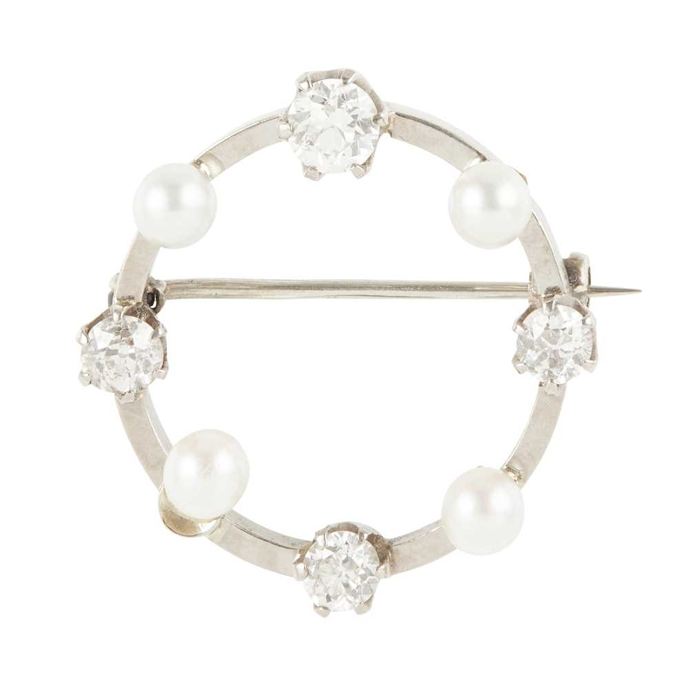 Lot 17 - A diamond and pearl set brooch