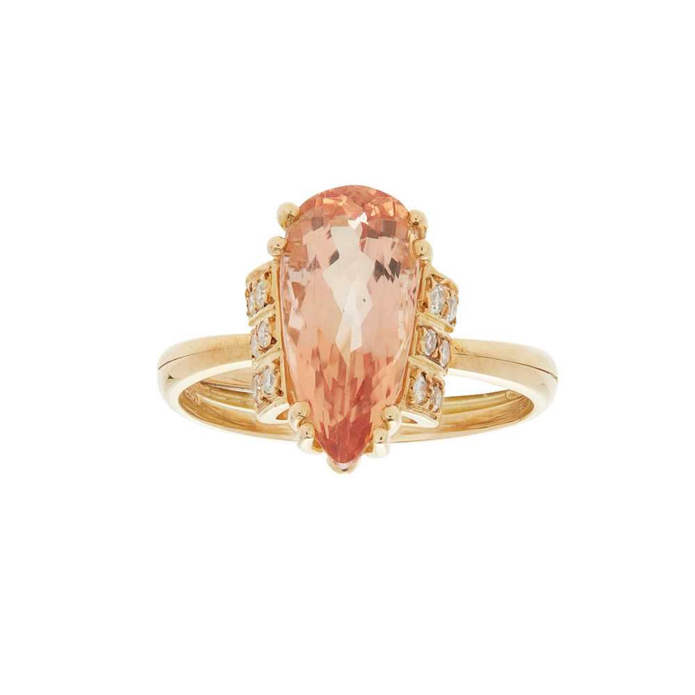 Lot 9 - An imperial topaz and diamond set ring