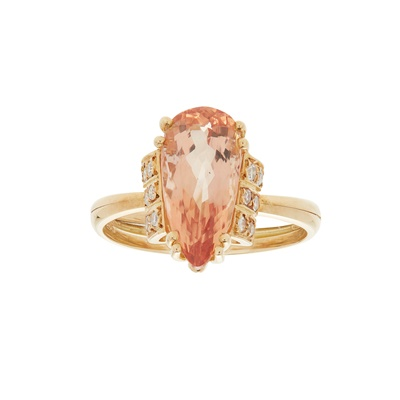 Lot 9-An imperial topaz and diamond set ring