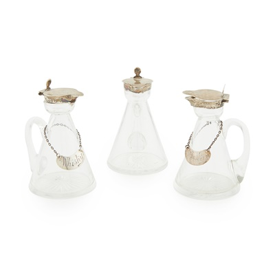 Lot 435 - A set of three silver mounted noggins