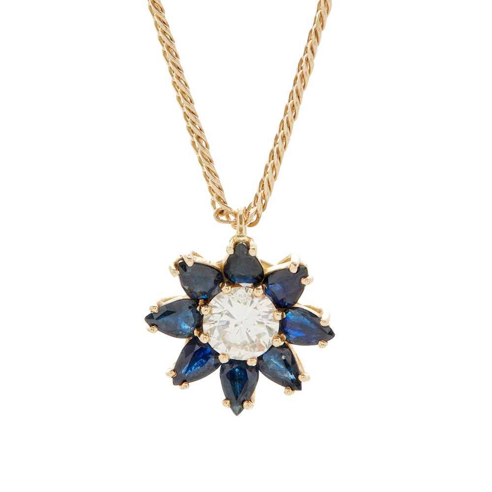 Lot 10 - A sapphire and diamond set cluster pendant