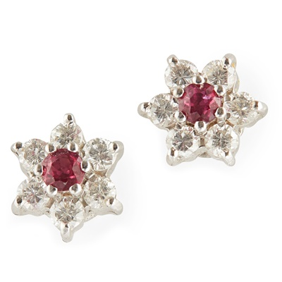 Lot 70 - A pair of ruby and diamond set cluster earrings