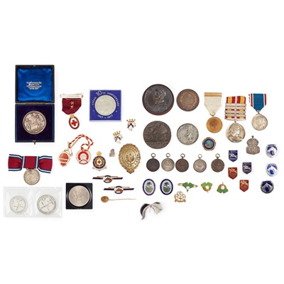Lot 98 - A group of 18th to 20th century medals, badges etc.