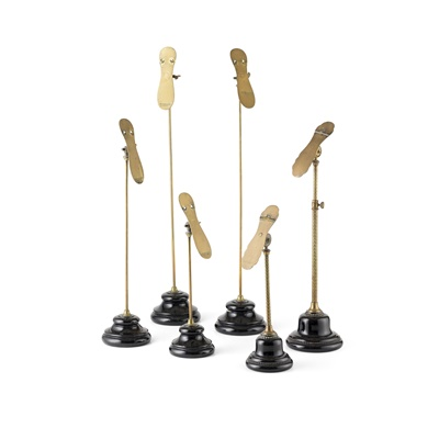 Lot 20 - GROUP OF BRASS AND POTTERY SHOE DISPLAY STANDS