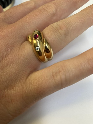Lot 69 - A ruby and diamond-set ring, by Cartier