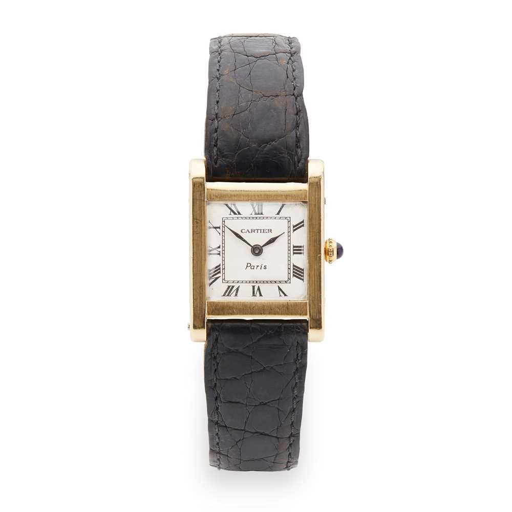Lot 141 - Cartier: a gold wrist watch