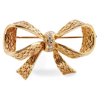 Lot 35 - A diamond set bow brooch,  Boucheron