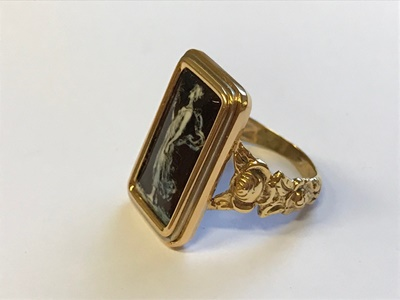 Lot 2 - A enamelled plaque ring