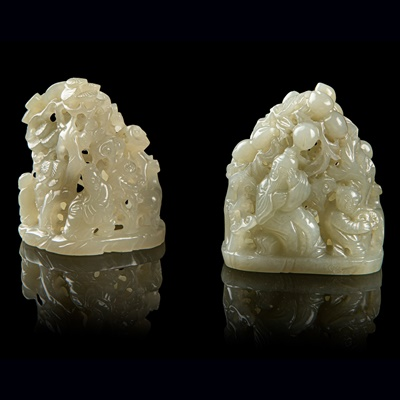 Lot 23 - TWO PALE CELADON JADE CARVING OF SMALL BOULDERS
