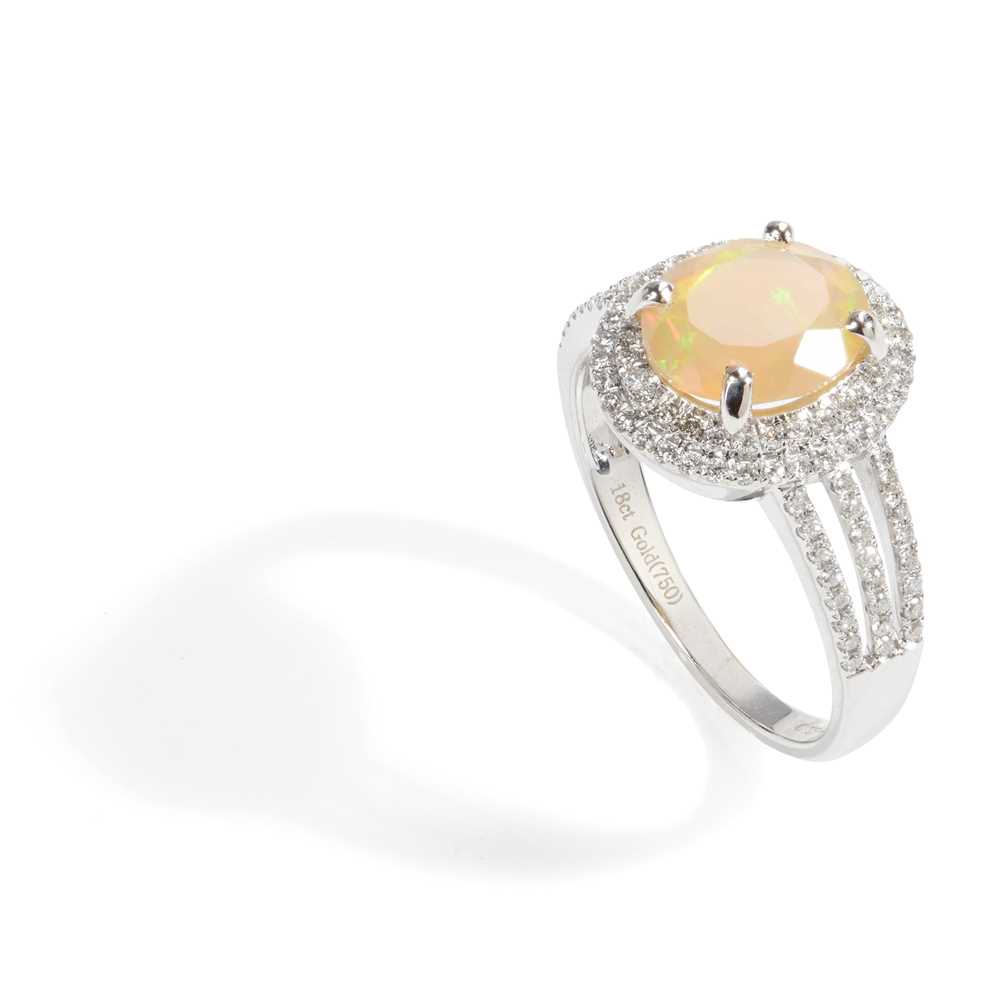 Lot 42 - An opal and diamond set cluster ring