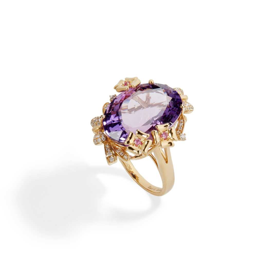 Lot 56 - An amethyst, diamond and sapphire set cocktail ring