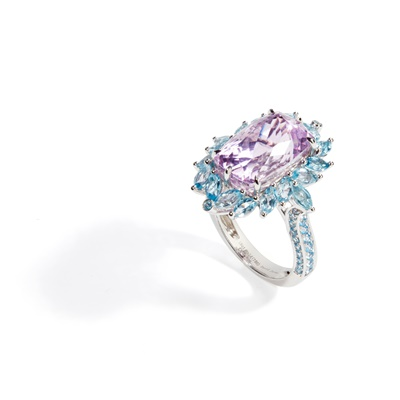 Lot 50 - A kunzite and blue topaz set cocktail ring