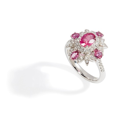 Lot 12 - A ruby and diamond set cluster ring