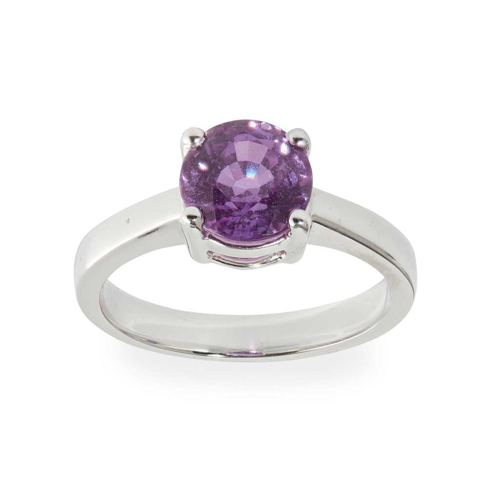 Lot 13 - A pinkish-purple sapphire set ring