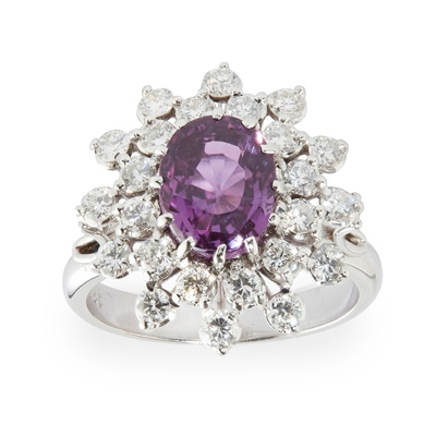 Lot 71 - A pink sapphire and diamond set cluster ring