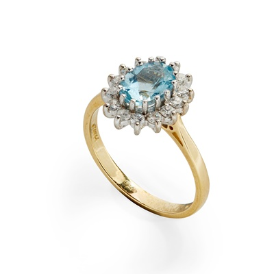 Lot 20 - An aquamarine and diamond set cluster ring