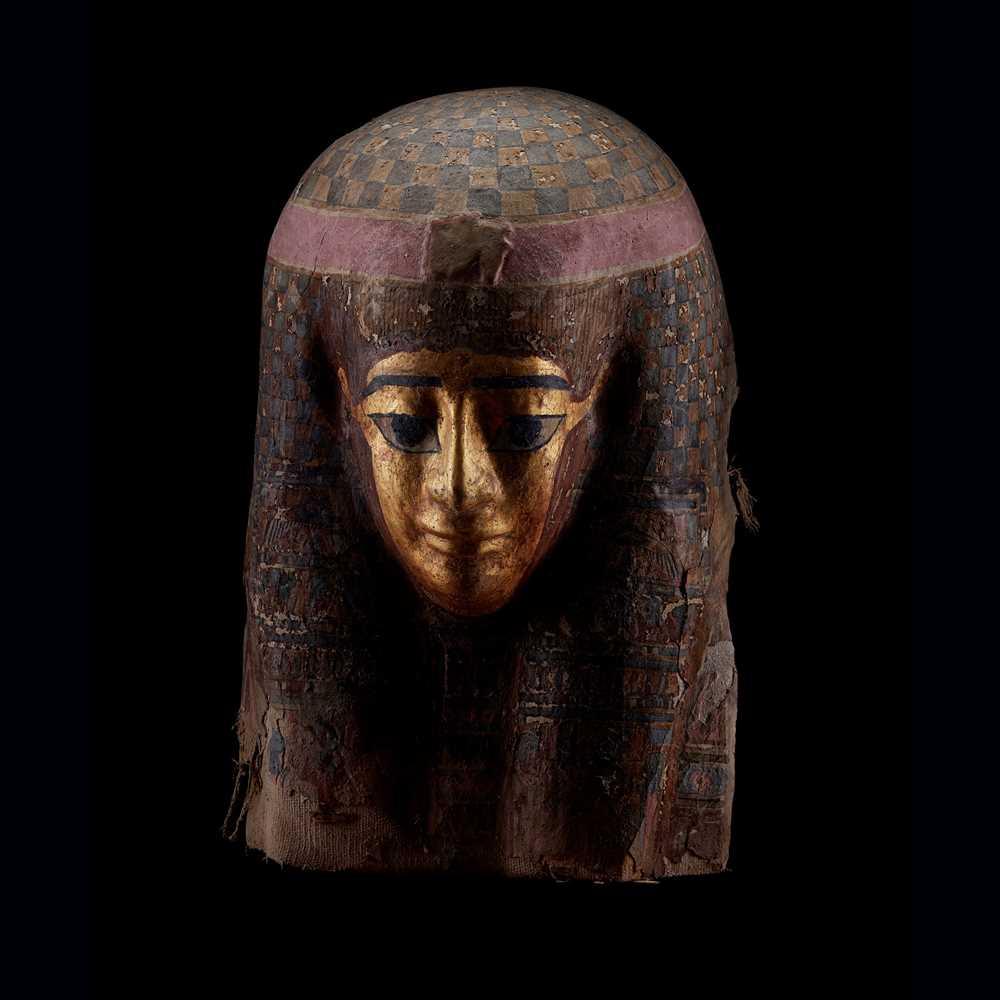 Lot 113 - AN ANCIENT EGYPTIAN PTOLEMAIC GILT CARTONNAGE MASK