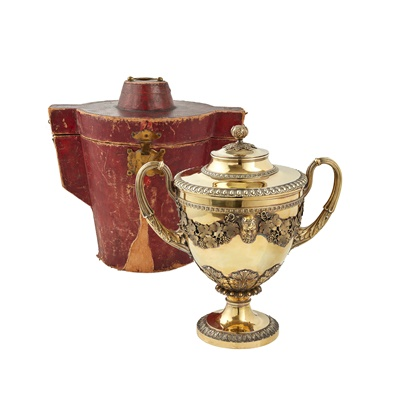 Lot 335 - An impressive cased George III silver-gilt twin handled cup and cover