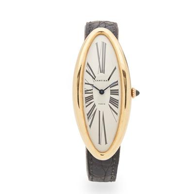 Lot 129 - Cartier: a gold wrist watch