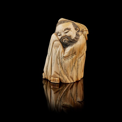 Lot 18 - IVORY CARVING OF A NAPPING SCHOLAR