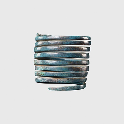 Lot 96 - BRONZE AGE COILED RING