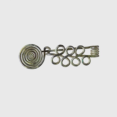 Lot 104 - BRONZE AGE COILED BROOCH