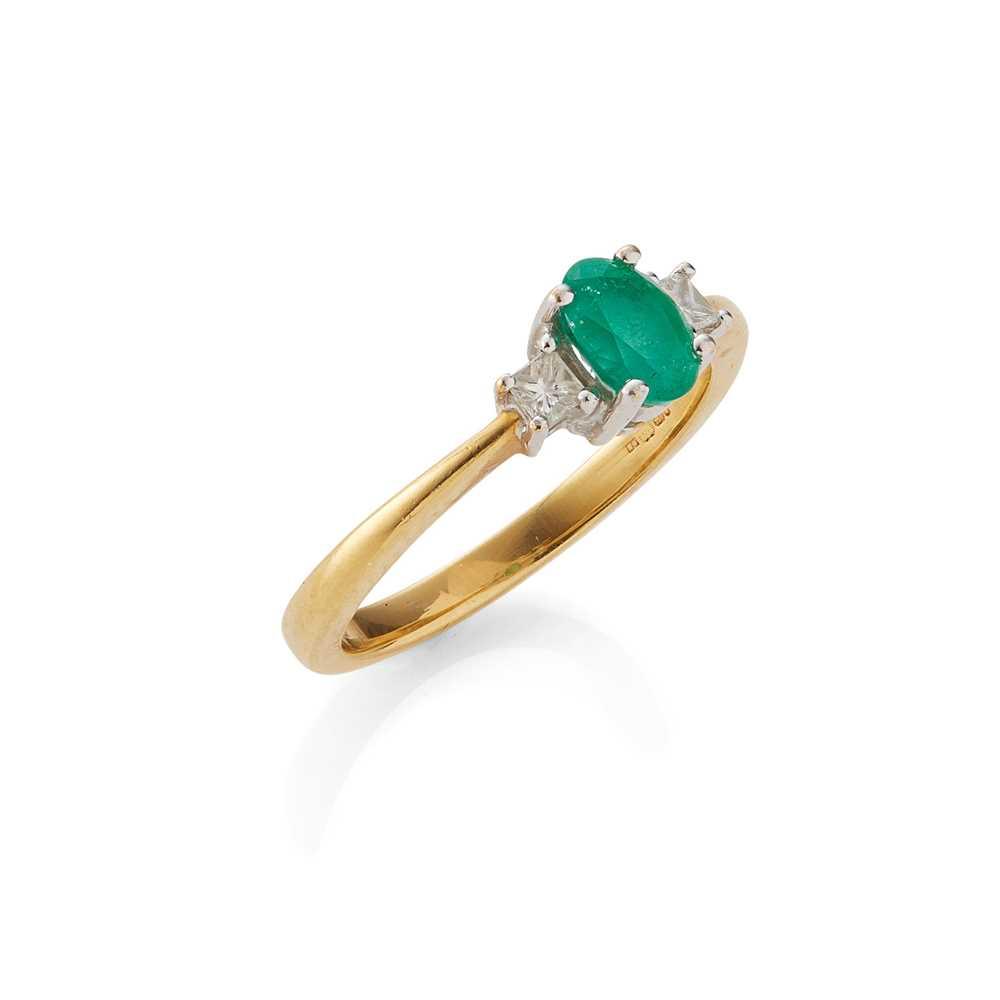 Lot 69 - An emerald and diamond three-stone ring