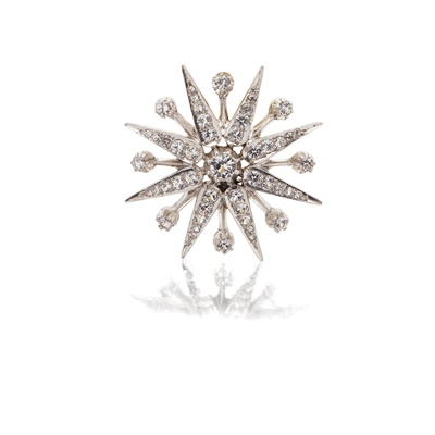 Lot 72 - An imitation diamond set star pendant