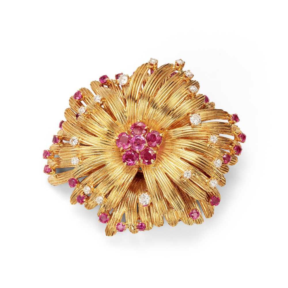 Lot 24 - A ruby and diamond-set flower brooch / pendant