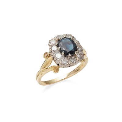 Lot 95 - A sapphire and diamond set cluster ring