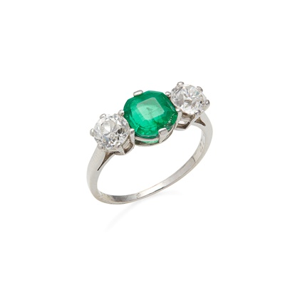 Lot 48 - An emerald and diamond set three stone ring