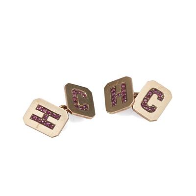 Lot 37 - GOLFING INTEREST - A pair of ruby set cufflinks