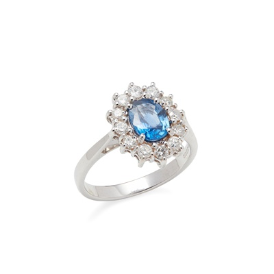 Lot 11 - A sapphire and diamond set cluster ring