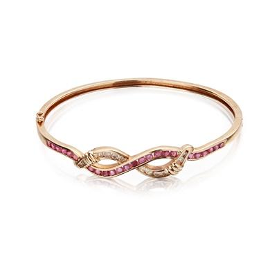 Lot 42 - A ruby and diamond set bangle