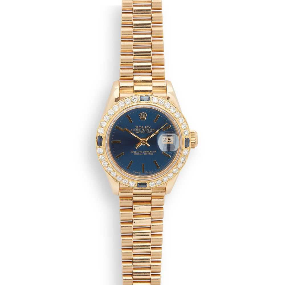 Lot 140 - Rolex: a lady's gold wrist watch