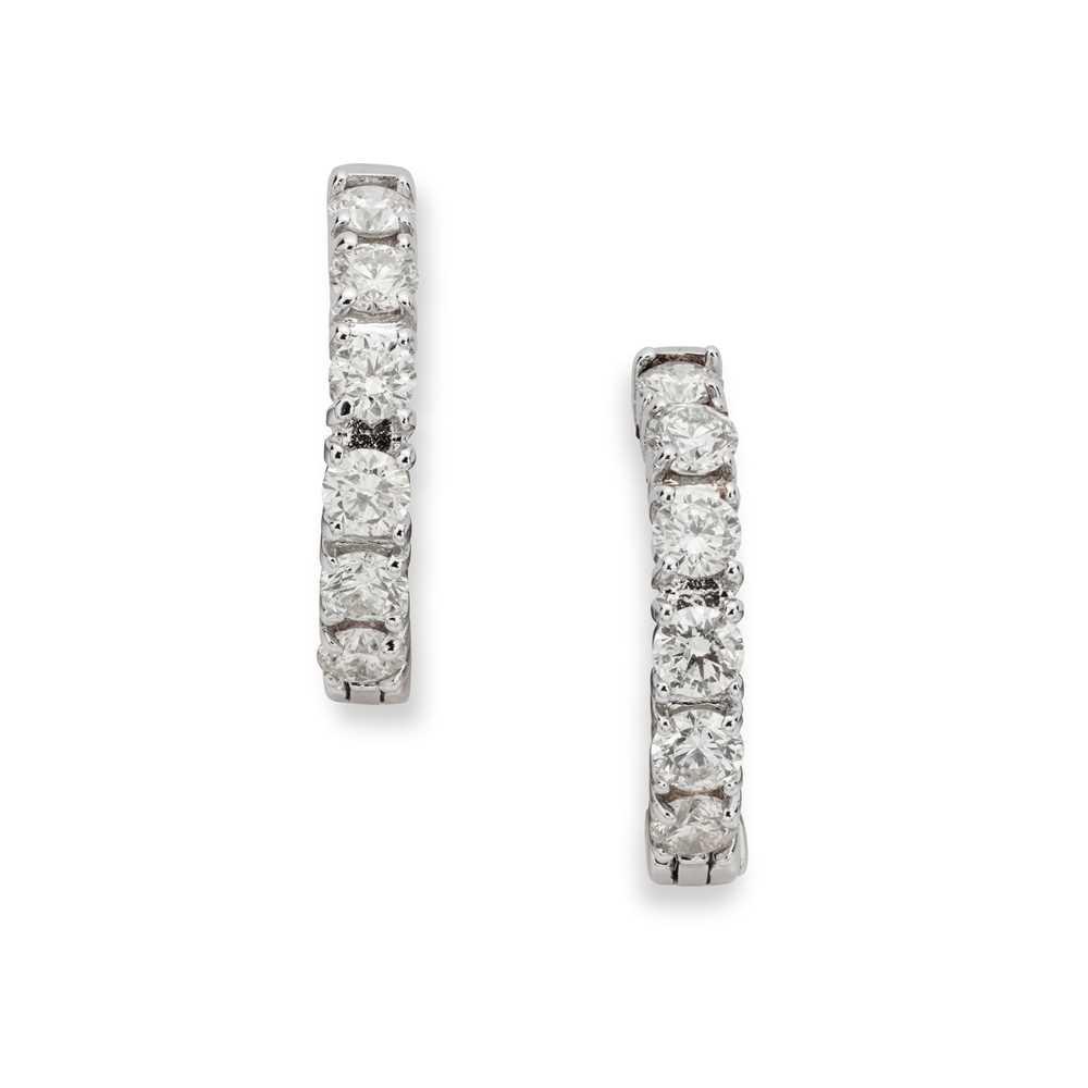 Lot 102 - A pair of diamond earrings