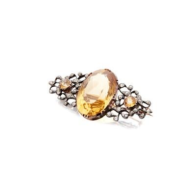 Lot 25 - A citrine and diamond set brooch