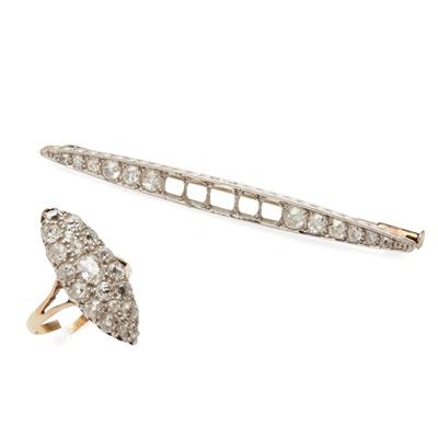 Lot 103 - A diamond set navette cluster ring