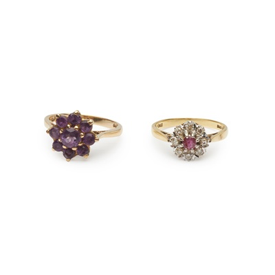 Lot 180 - A ruby and diamond cluster ring