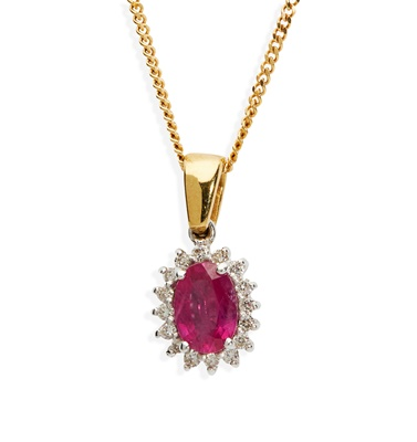 Lot 31 - A pink sapphire and diamond pendant necklace