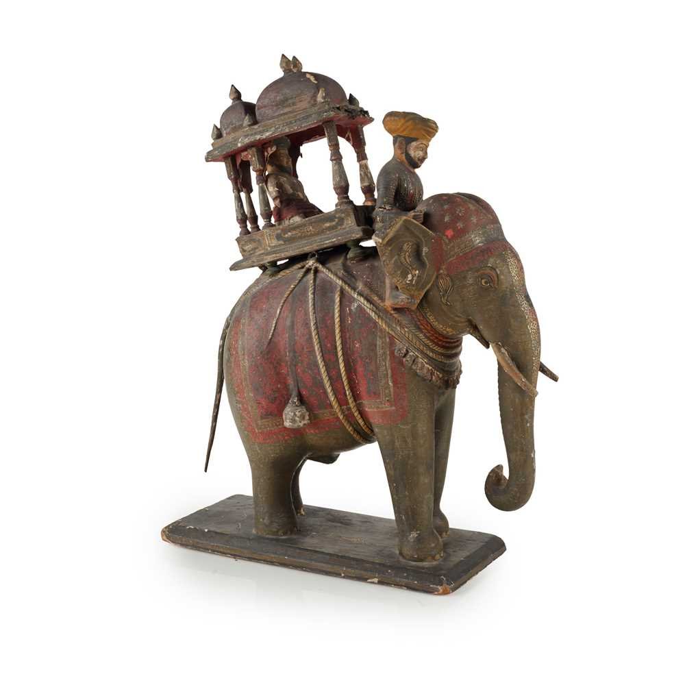 Lot 22 - AN INDIAN CARVED AND PAINTED WOOD AND GESSO MODEL OF AN ELEPHANT AND HOWDAH