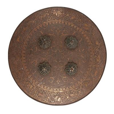 Lot 21 - AN INDIAN GOLD KOFTGARI STEEL DHAL SHIELD
