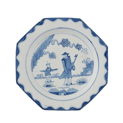 Lot 42 - BOW OCTAGONAL GOLFER AND CADDY PATTERN BLUE PAINTED PLATE