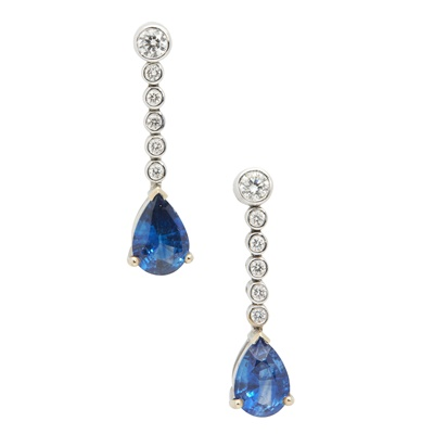Lot 75 - A pair of sapphire and diamond pendent earrings