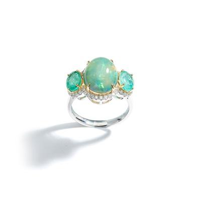 Lot 22 - An opal, emerald and diamond three-stone ring
