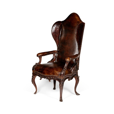Lot 460 - NORTH ITALIAN WALNUT AND BROWN LEATHER WING ARMCHAIR