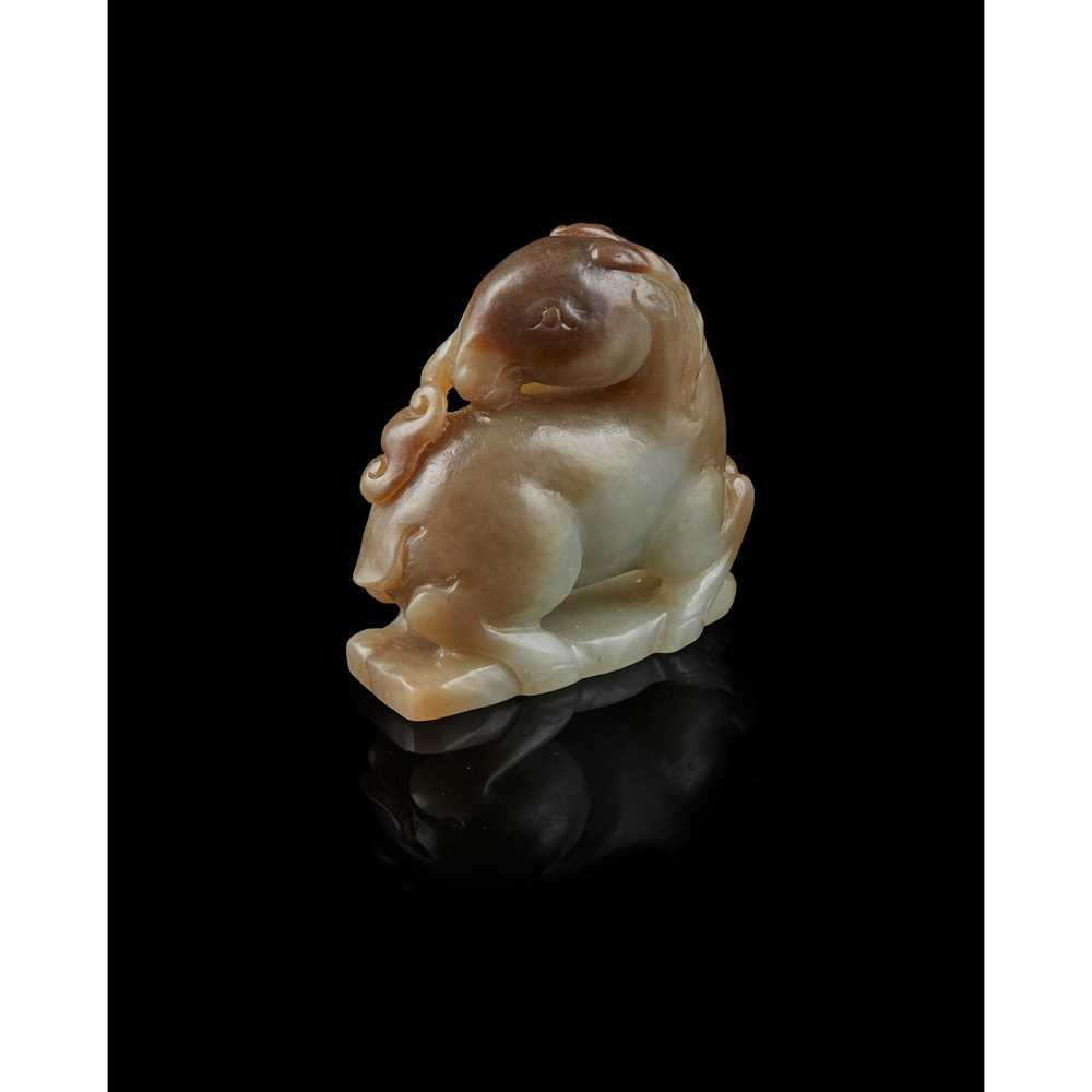 Lot 56 - CELADON AND RUSSET JADE CARVING OF RAM