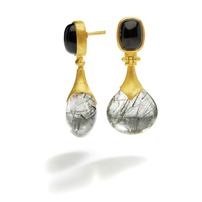 Lot 93 - A pair of onyx and rutilated quartz earrings