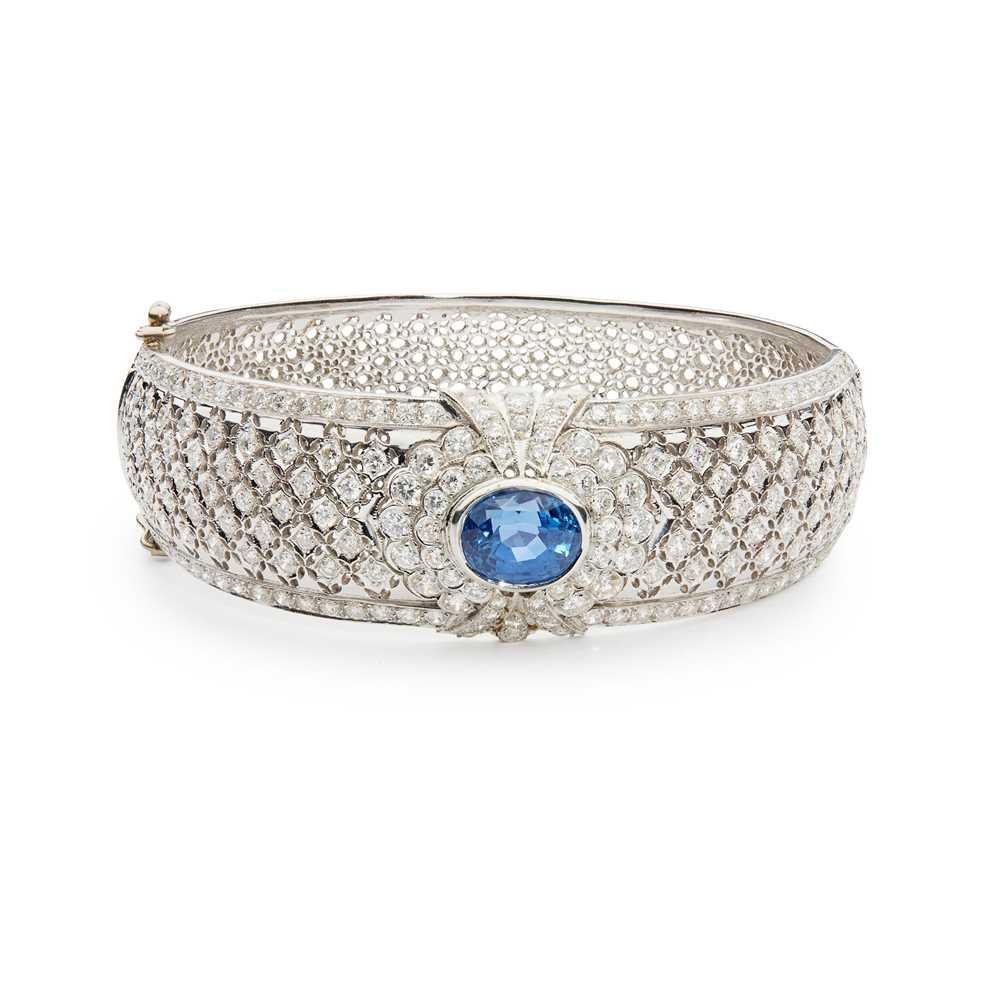 Lot 74 - A sapphire and diamond bangle